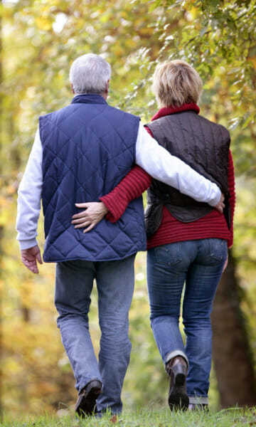 Couple walking together in a park - Carotid Disease & Stroke page image